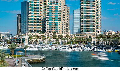 View of Dubai Marina modern Towers in Dubai at day time timelapse