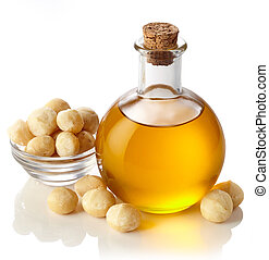 Macadamia nut oil - Bottle of macadamia nut oil isolated on...