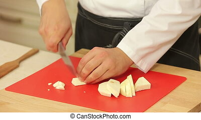 Chopping celery root into cubes - Chef is chopping celery...