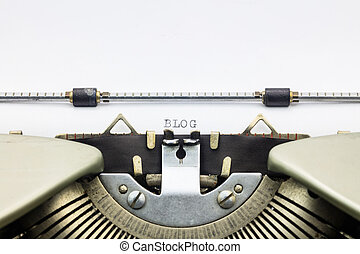 Blog word in capital letters on white sheet - Close-up of...
