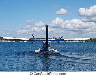 Seaplane - seaplane prepare for take off, back side view...