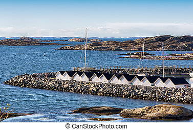 Boathouses on the swedish westcoast - Seascape with rocks...