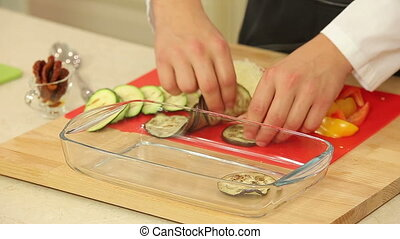 Chef is cooking vegetable lasagna at the kitchen
