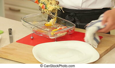 Chef is cooking vegetable lasagna - Chef is serving a...