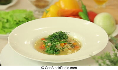 Freshly cooked soup with beans and vegetables - A plate of...