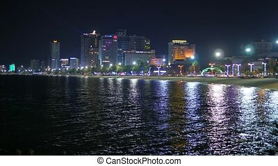 Night lights of the big city being reflected in sea water. Nha Trang, Vietnam