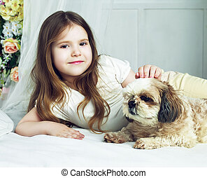girl with a dog - happy girl with her dog in bed at home