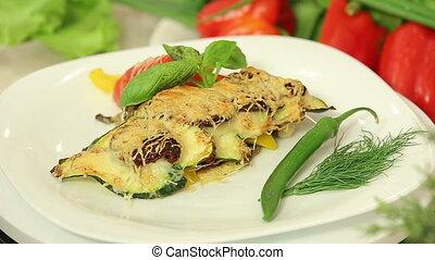 Freshly baked vegetable lasagna - Presentation of a portion...