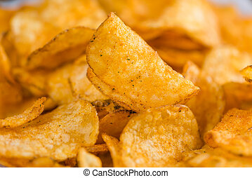 Heap of Chilli Potato Chips (selective focus) on an old...