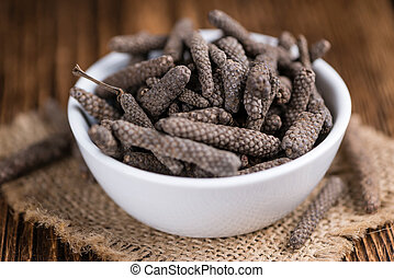 Heap of long Pepper selective focus on wooden background...