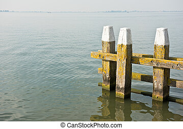 Northern Sea landscape: still water and wooden pier