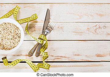 Bowl of porridge on wooden table