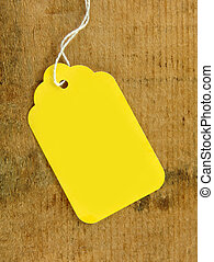 Yellow Tag on Wood