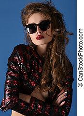 Portrait of stylish brunette female model in sunglasses -...