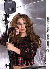 Portrait of female model on a background silver umbrella -...