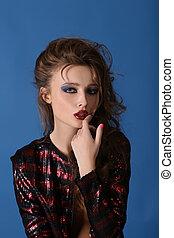 Portrait of brunette female model with bright make-up...