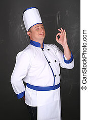 Portrait of chef and hand doing gesture is all right -...