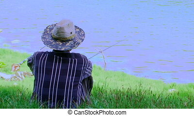 A fisherman on the river