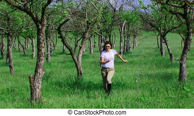The girl in the apple orchard