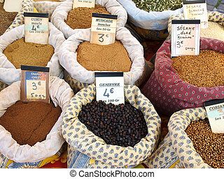 Spices at the market - bags of spices at a market in...