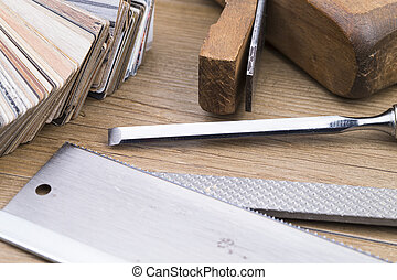 Woodwork - Tools and samples of inlay on wooden table