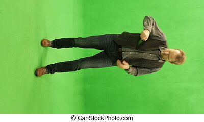 Chromakey. Man doing photo on the smartphone - Green screen....
