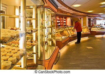 bakery shop - interior of bakery shop with customer