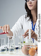 Portrait of Female Lab Staff Dealing With Flasks and Its Substances in Laboratory Environment