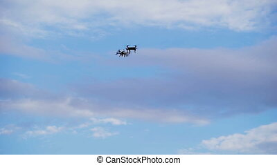Two drone hovered in the background of the sky. Modern...