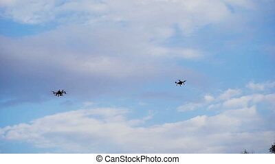 Drones hovered in the background of the sky. Modern...