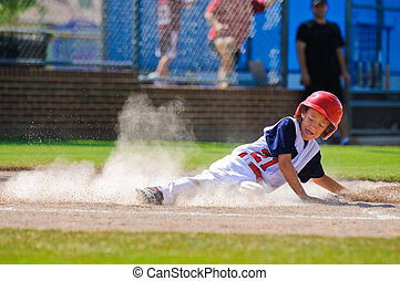 Little league baseball player sliding home. - Youth baseball...