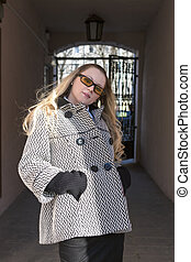 Fashionable Trendy Caucasian Blond WomanPosing in Sunglasses...