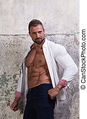 Muscular man on concrete background - Muscular hot man poses...