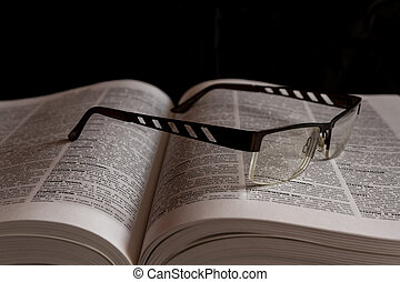 Glasses on Russian Cyrillic dictionary - Russian English...