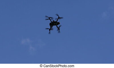 Drone hovered in the background of the sky. Modern...