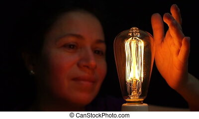 Woman Antique Filament Bulb Amused - Close up front view...