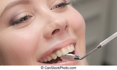Dentist examines incisors of patient - Close up of dentist...