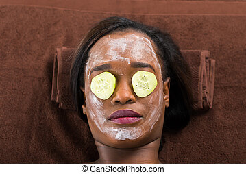 Woman With Facial Mask In Spa