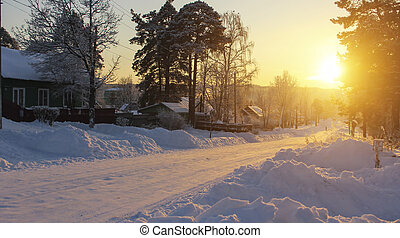 Russian village landscape. Road in the snow during a...