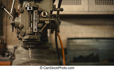 Detail of a drill press. - Detail of a drill press in a...