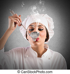 Delicious taste - Woman taster chef tastes a steaming ladle