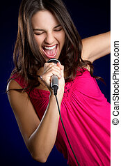 Singing Girl - Teen girl singing into microphone