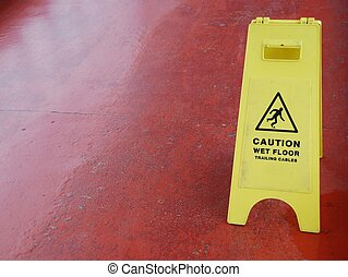 Wet floor sign - yellow caution sign regarding slippery...