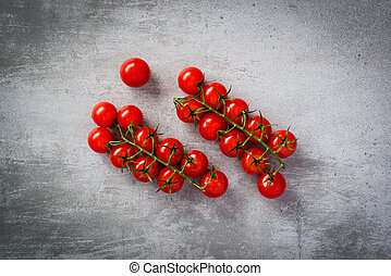 Tomatoes on concrete background - Small tomatoes on concrete...