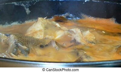 Delicious dish of fisherman Fish stew - kitchen on open fire...