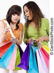 Shopping spree - Stock image of two surprised young women...