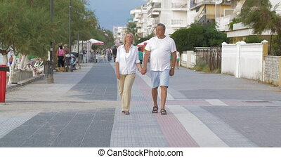Couple of man and woman walking down the street