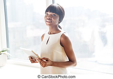 Businesswoman holding tablet compute - Attractive afro...