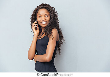 Happy woman talking on the phone - Happy afro american woman...