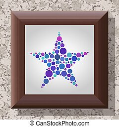 Star shape in wooden frame hanging on a marble wall
